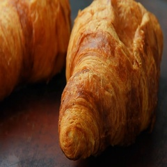 Fresh unfilled croissants for breakfast Stock Footage