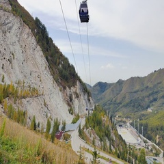 Almaty, Kazakhstan - August 30, 2016: Ice skating rink Medeo and funicular from Stock Footage
