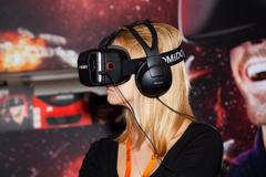 Girl playing with Homido virtual reality headset on Robotics Expo in Moscow Kuvituskuvat
