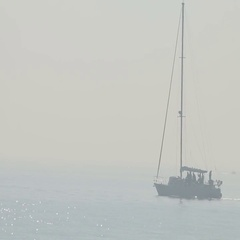 Tall ship sails on the open seas, misty foggy day Stock Footage