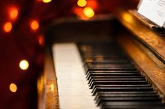 Piano with lights in background Stock Photos