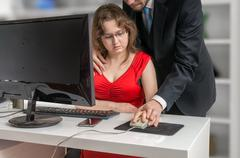 Boss or manager is seducting his secretary in office. Harassment and mobbing con Stock Photos