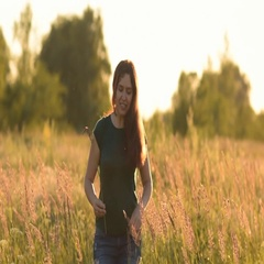 Good beautiful young woman outdoors. Is on camera holding a plant. Stock Footage