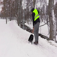 Janitor clean sidewalk from the snow in winter Stock Footage