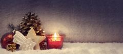 Christmas cookies and red advent candle . Stock Photos
