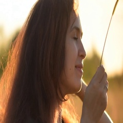 The beauty of a romantic young woman outdoors. Looking to the right and dreams. Stock Footage