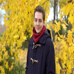 Young man Portrait of a coat in the fall with yellow leaves near Stock Footage