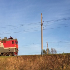 Freight train rides on rails against the blue sky. Stock Footage