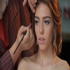 Making green smokey eyes for a girl Stock Footage
