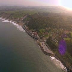 British resort town reveal shot at sunset.North England, UK. Aerial view Stock Footage