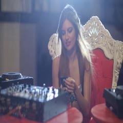 Beautiful girl DJ preparing for a work Stock Footage