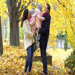 Happy family walking  in the park in autumn. Parents and two dau Stock Footage