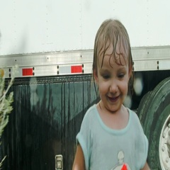 Toddler Running in the Rain Stock Footage