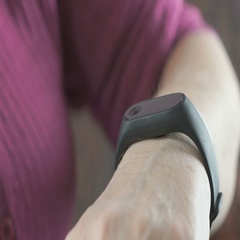 Woman looks at the results of physical activity using the smart fitness watch Stock Footage