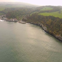 Natural coastline with small village,North England, Scarborough, UK Stock Footage