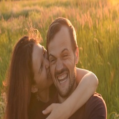 Happy romantic couple taking a selfie outdoors. A young girl bites a guy's ear. Stock Footage