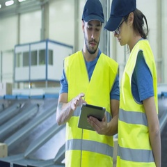 Two Post Sorting Center Workers Using Tablet while Having Conversation. Stock Footage