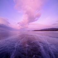 4K. Sunset in the icy Lake Baikal in the red colors, Irkutsk region, Russia.  Stock Footage