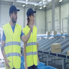 Two Post Sorting Center Workers Walking Along Belt Conveyor Stock Footage