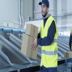 People Working at Post Sorting Center. Hispating Ethnicity Young Man Carries Car Stock Footage