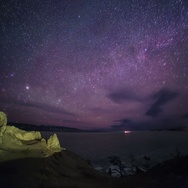 4K. Starry night over the island Olkhon. Burkhan Cape, Olkhon island Stock Footage