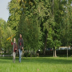 Father and Son are Running in with Model Airplane in the Park.  Stock Footage