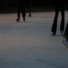 Large crowd of people ice skating in different directions - shot from waist down Stock Footage