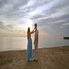 Pregnant couple on beach at sunrise. Man and woman on sea beach Stock Footage