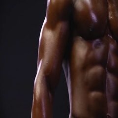 African american bodybuilder flexing muscles Stock Footage