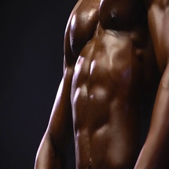 African American in front of black background flexing muscles Stock Footage