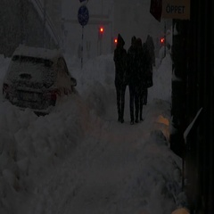 People walking under a very heavy snow - bad weather condition Stock Footage