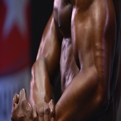 African Man flexing muscles on black background Stock Footage