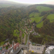 Beautiful resort town in the valley next to the sea. Aerial view Stock Footage