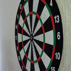 Darts stuck in the target Stock Footage