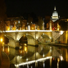 Amazing night view over the Bridges of Rome and St Peters Basilica Stock Footage