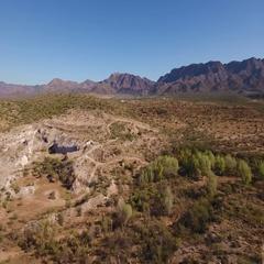 High Angle Aerial Flyover Establishing Shot of the Arizona Desert   Stock Footage