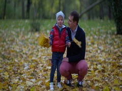 Happy child playing outdoors in autumn park Stock Footage