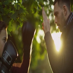 Father Teaches his Son Boxing with Gloves. Recreactional Activities in the Autum Stock Footage