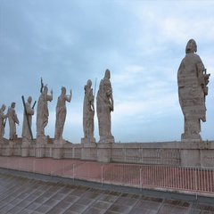 Big statues n the rooftop of Saint Peters Basilica in Rome Stock Footage