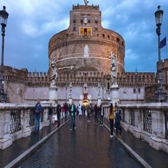 Angels Bridge to Castel Sant Angelo - the famous Angels Castle in Rome Stock Footage