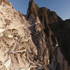 Aerial shot, the worlds famous Carrara marble caves with the soft sunset  Stock Footage