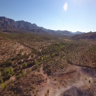 High Angle Aerial Flyover Establishing Shot of the Arizona Desert  	 Stock Footage