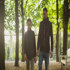 Father and Son Walking in the Park. Frontal View Shot. Stock Footage