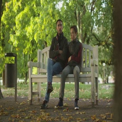 Father and Son are Sitting in the Park and Talking. Beautiful Autumn Weather. Stock Footage