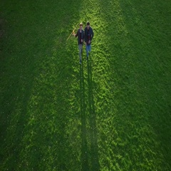 Father and Son Running with Model Airplane in The Park. Aerial Shot. Stock Footage