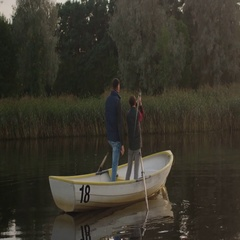 Father and Son are Standing in the Boat while Fishing. Son Swings Fishing Rod. F Stock Footage