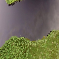 Aerial tilt shot revealing a forest lake in Finnish landscape Stock Footage