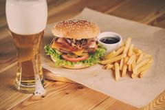 Fish and Chips Burger with fried potato straw, fresh salad  cold beer Stock Photos