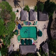 PHUKET, THAILAND November 29, 2015: Aerial: Pool on the palm beach. Stock Footage