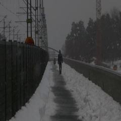 Rear shot of people walking under a very heavy snow - bad weather condition Stock Footage